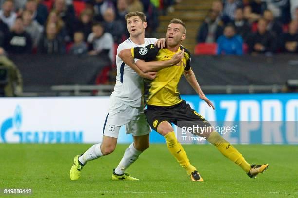 Ben Davies of Tottenham and Andrey Yarmolenko of Dortmund battle for the ball during the UEFA Champions League group H match between Tottenham...