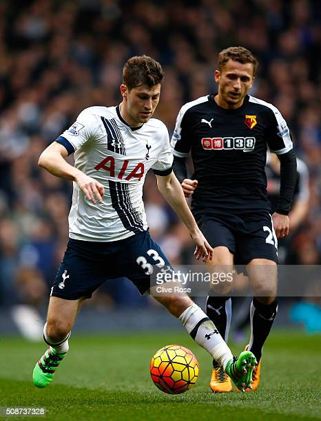 Ben Davies of Tottenham Hotspur and Almen Abdi of Watford compete for the ball during the Barclays Premier League match between Tottenham Hotspur and...