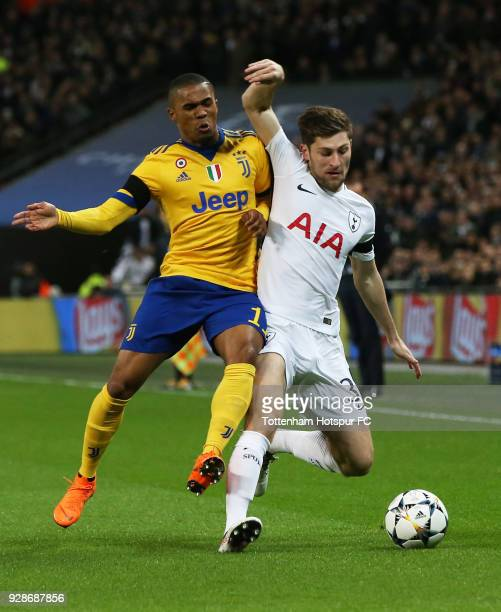 Ben Davies of Tottenham Hotspur and Douglas Costa of Juventus battle for the ball during the UEFA Champions League Round of 16 Second Leg match...