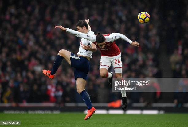 Ben Davies of Tottenham Hotspur and Hector Bellerin of Arsenal battle for possession in the air during the Premier League match between Arsenal and...
