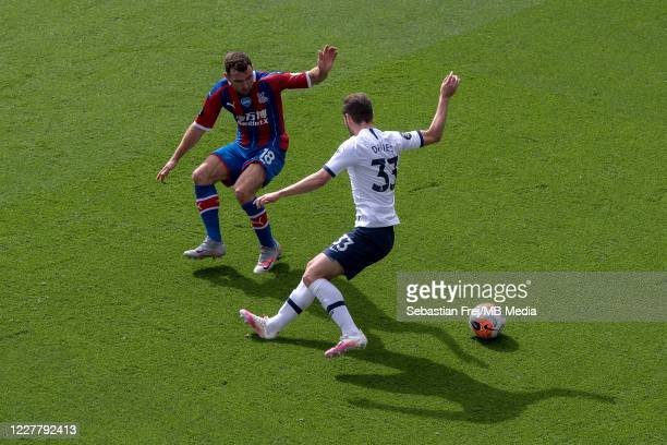 Ben Davies of Tottenham Hotspur and James McArthur of Crystal Palace in action during the Premier League match between Crystal Palace and Tottenham...