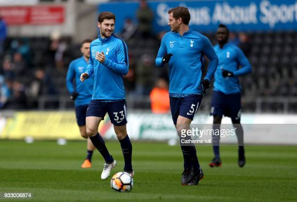 Ben Davies of Tottenham Hotspur and teammate Jan Vertonghen warm up prior to The Emirates FA Cup Quarter Final match between Swansea City and...