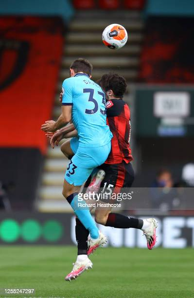 Ben Davies of Tottenham Hotspur battles for possession with Adam Smith of AFC Bournemouth and Adam Smith goes down injured after during the Premier...
