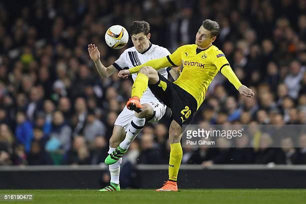 Ben Davies of Tottenham Hotspur battles with Lukasz Piszczek of Borussia Dortmund during the UEFA Europa League round of 16 second leg match between...