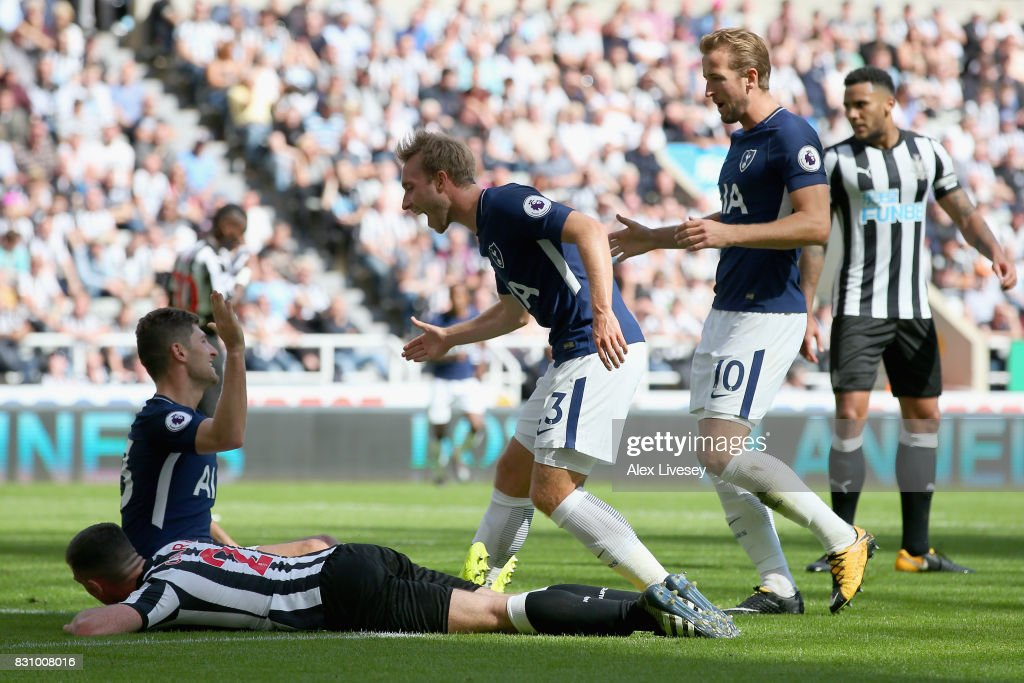 Ben Davies of Tottenham Hotspur celebrates scoring his sides second goal with Christian Eriksen of Tottenham Hotspur and Harry Kane of Tottenham Hotspur during the Premier League match between Newcastle United and Tottenham Hotspur at St. James Park on August 13, 2017 in Newcastle upon Tyne, England.