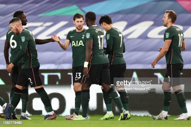 Ben Davies of Tottenham Hotspur celebrates with team mates Davinson Sanchez, Moussa Sissoko, Heung-Min Son and Harry Kane after scoring their sides...