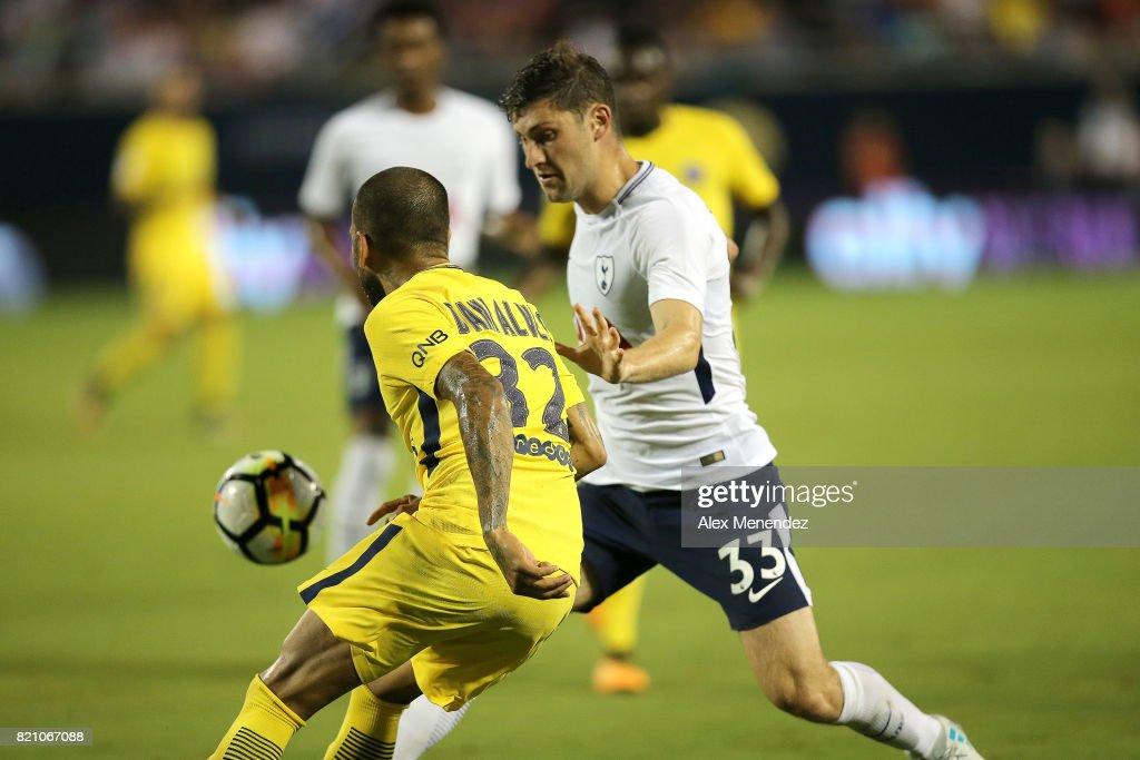 Ben Davies #33 of Tottenham Hotspur defends against Dani Alves #32 of Paris Saint-Germain during the International Champions Cup 2017 match between Paris Saint-Germain and Tottenham Hotspur at Camping World Stadium on July 22, 2017 in Orlando, Florida.