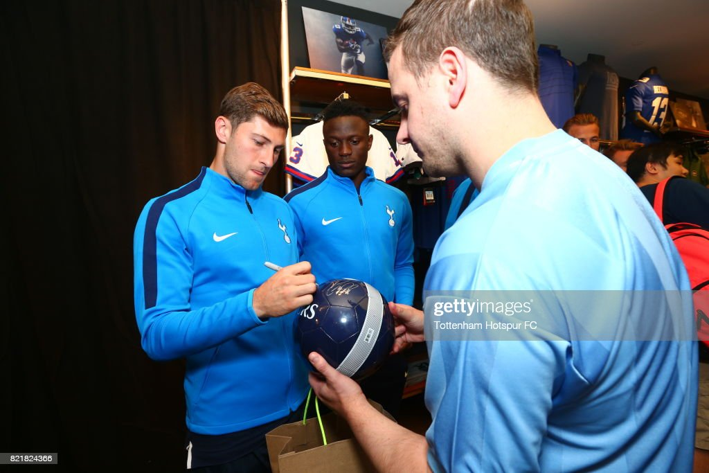 Ben Davies of Tottenham Hotspur FC signs a ball for a fan on a visit to Nike Town on Tottenham Hotspur Pre-Season Tour to the US on July 23, 2017 in New York, New York.
