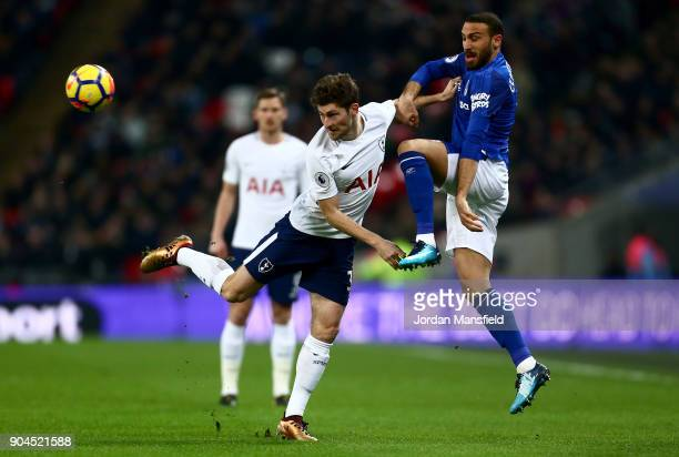 Ben Davies of Tottenham Hotspur is challenged by Cenk Tosun of Everton during the Premier League match between Tottenham Hotspur and Everton at...