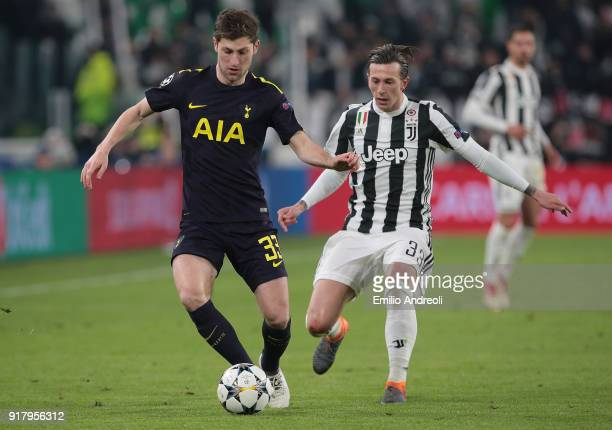 Ben Davies of Tottenham Hotspur is challenged by Federico Bernardeschi of Juventus FC during the UEFA Champions League Round of 16 First Leg match...