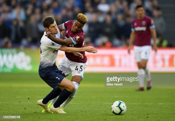 Ben Davies of Tottenham Hotspur is challenged by Grady Diangana of West Ham United during the Premier League match between West Ham United and...