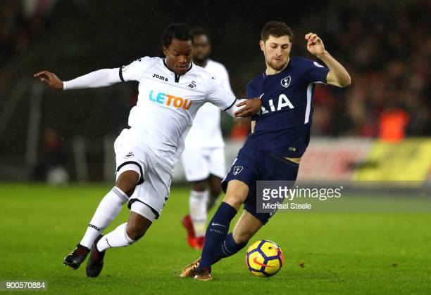 Ben Davies of Tottenham Hotspur is challenged by Renato Sanches of Swansea City during the Premier League match between Swansea City and Tottenham...