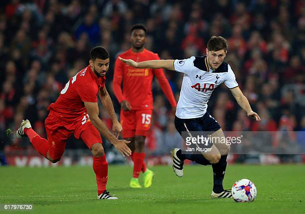 Ben Davies of Tottenham Hotspur is chased down by Kevin Stweart of Liverpool during the EFL Cup fourth round match between Liverpool and Tottenham...