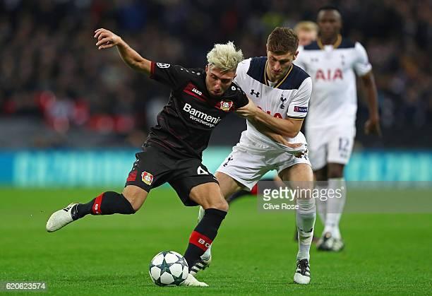 Ben Davies of Tottenham Hotspur makes a tackle on Kevin Kampl of Bayer Leverkusen during the UEFA Champions League Group E match between Tottenham...