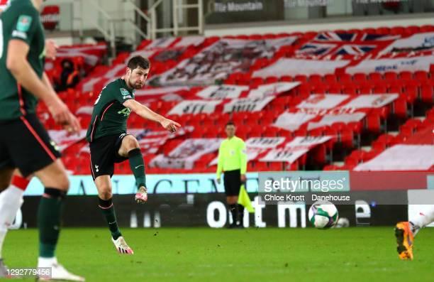 Ben Davies of Tottenham Hotspur scores his teams second goal during the Caraboa Cup Quarter Final match between Stoke City and Tottenham Hotspur at...