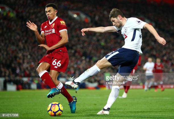 Ben Davies of Tottenham Hotspur shoots as Trent Alex Arnold of Liverpool attempts to block during the Premier League match between Liverpool and...