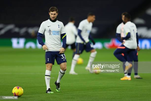 Ben Davies of Tottenham Hotspur warms up whilst wearing a shirt spreading awareness for Prostate Cancer UK following the recent death of former...