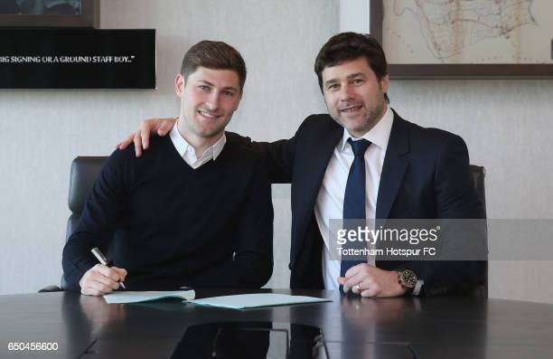 Ben Davies of Tottenham signs a new contract with manager Mauricio Pochettino at Tottenham Hotspur training Centre on March 9 2017 in Enfield England