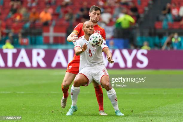 Ben Davies of Wales and Martin Braithwaite of Denmark battle for the ball during the UEFA Euro 2020 Championship Round of 16 match between Wales and...