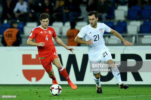 Ben Davies of Wales and Otar Kakabadze of Georgia in action during the FIFA 2018 World Cup Qualifier between Georgia and Wales at Boris Paichadze...