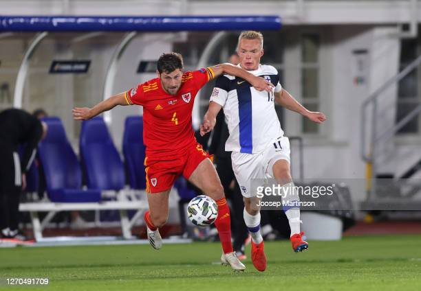Ben Davies of Wales battles for possession with Ilmari Niskanen of Finland during the UEFA Nations League group stage match between Finland and Wales...