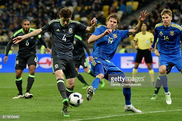 Ben Davies of Wales is challenged by Denys Garmash of Ukraine during the International Friendly match between Ukraine and Wales at NSK Olimpijskyj on...