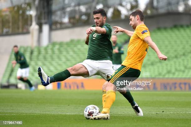 Ben Davies of Wales shoots past Shane Long of Republic of Ireland during the UEFA Nations League group stage match between Republic of Ireland and...