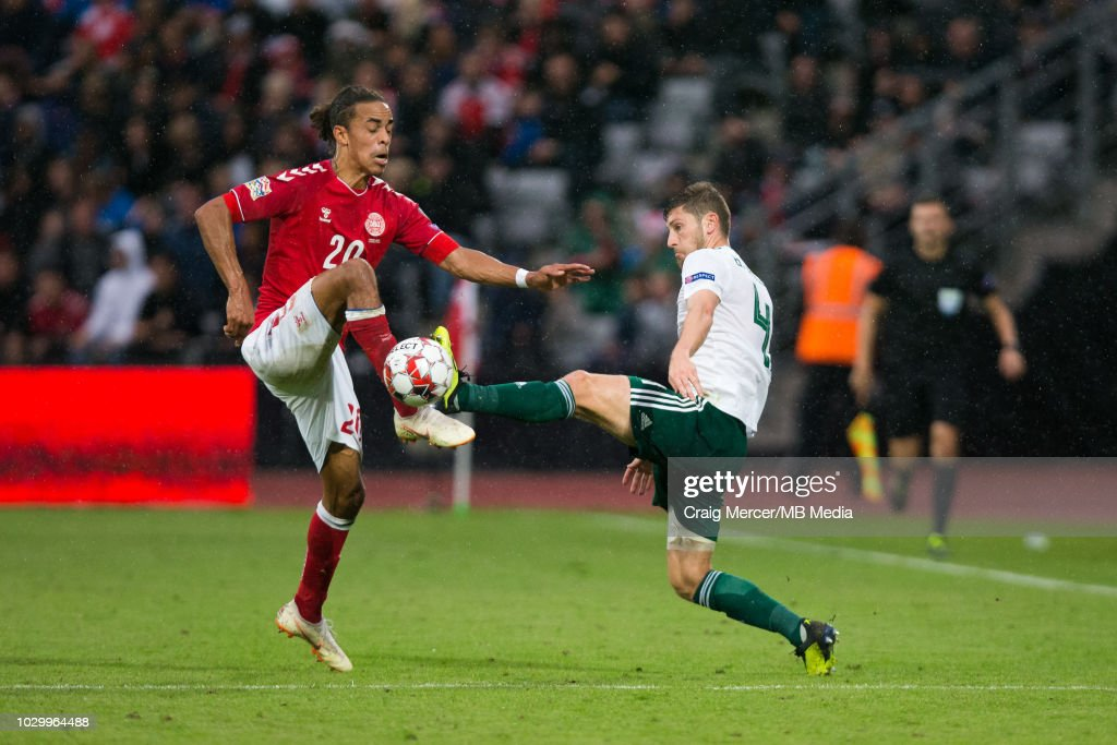 Ben Davies of Wales vies for possession with Yussuf Poulsen of Denmark during the UEFA Nations League B group four match between Denmark and Wales at on September 9, 2018 in Aarhus, Denmark.