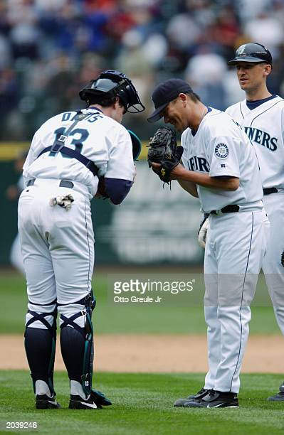 Ben Davis and Kazuhiro Sasaki of the Seattle Mariners congratulate each other after the game against the Kansas City Royals at Safeco Field on May 22...