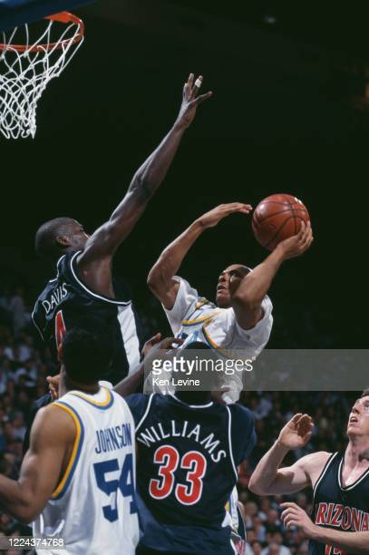 Ben Davis, Forward for the University of Arizona Wildcats attempts to block Charles O'Bannon Shooting Guard for the University of California, Los...
