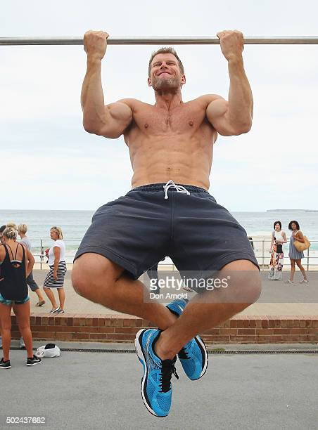 Ben Davis from Freshwater Sydney is does chinups in the outdoor gym at Bondi Beach on December 25 2015 in Sydney Australia Bondi Beach is a popular...
