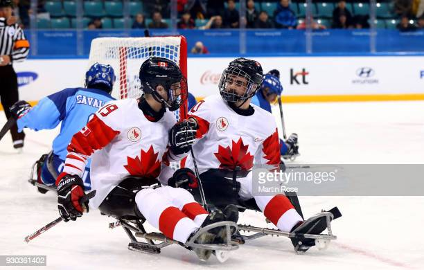 Ben Delaney of Canada celebrate with team mate Dom Cozzolino after he scores the 2nd goal in the Ice Hockey Preliminary Round Group A game between...