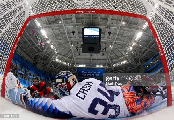 Ben Delaney of Canada fails to score over Steve Cash goaltender of United States in the Ice Hockey gold medal game between Canada and United States...