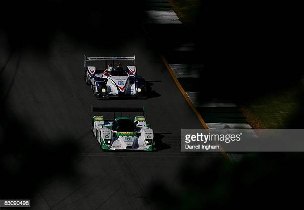 Ben Devlin in the LMP2 BK Motorsport Lola B06 leads Chris Dyson in the LMP2 Dyson Racing Porsche RS Spyder during practice for the American Le Mans...