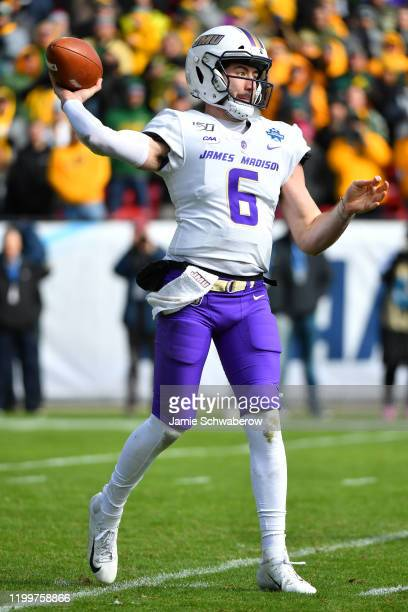 Ben DiNucci of the James Madison Dukes passes against the North Dakota State Bison during the Division I FCS Football Championship held at Toyota...