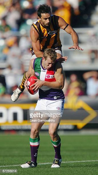 Ben Dixon for Hawthorn and Ryan Murphy for Fremantle in action during the round one AFL match between the Hawthorn Hawks and the Fremantle Dockers at...