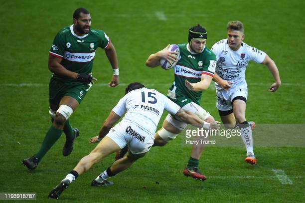Ben Donnell of London Irish is tackled by Bryce Heem of Toulon and Eben Etzebeth of Toulon during the European Rugby Challenge Cup Round 4 match...