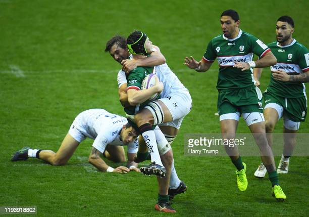 Ben Donnell of London Irish is tackled by Eben Etzebeth of Toulon during the European Rugby Challenge Cup Round 4 match between London Irish and...