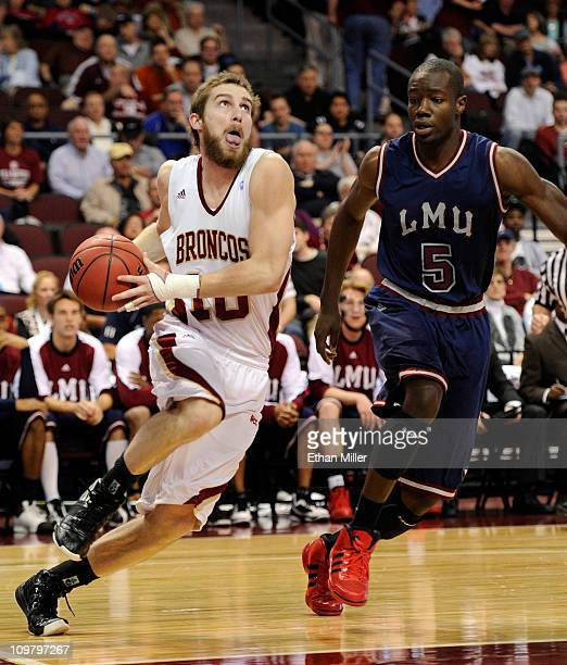 Ben Dowdell of the Santa Clara Broncos drives against Ashley Hamilton of the Loyola Marymount Lions during a quarterfinal game of the Zapposcom West...