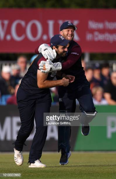 Ben Duckett and Brett Hutton of Northamptonshire Steelbacks celebrate the wicket of Calum MacLeod of Derbyshire Falcons during the Vitality Blast...
