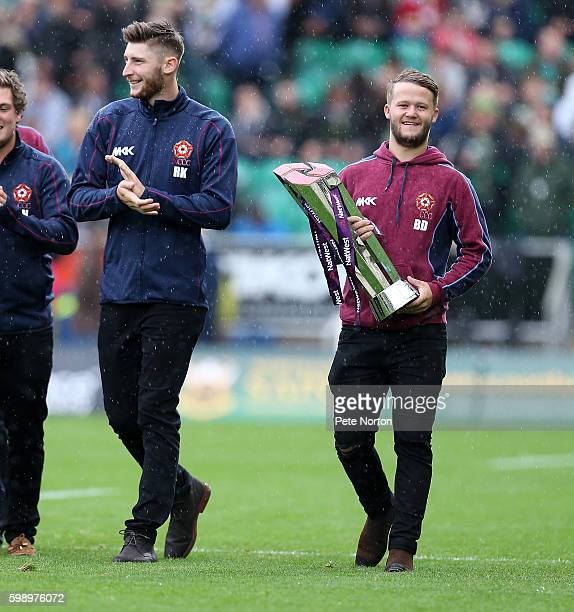 Ben Duckett and Rob Keogh of Northamptonshire Steelbacks parade the Nat West T20 Blast trophy at half time during the Aviva Premiership match between...