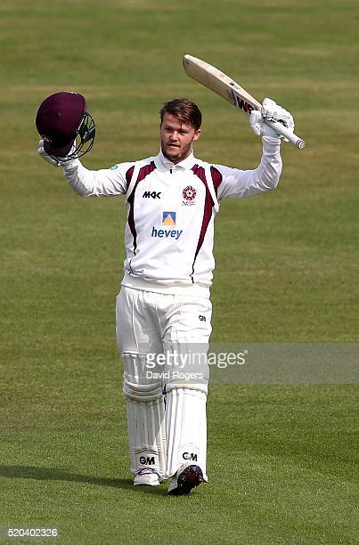 Ben Duckett of Northamptonshire celebrates after scoring a double century during the Specsavers County Championship division two match between...