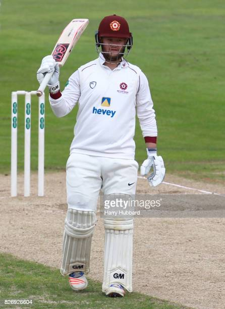 Ben Duckett of Northamptonshire celebrates his half century during the Specsavers County Championship Division Two match between Northamptonshire and...