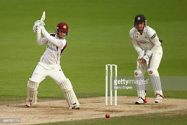 Ben Duckett of Northamptonshire hits out as Surrey wicketkeeper Gary Wilson looks on during day three of the LV County Championship Division Two...