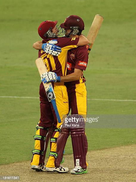 Ben Dunk and Ben Cutting of the Bulls celebrate winning the Ryobi One Day Cup match between the Western Australia Warriors and the Queensland Bulls...