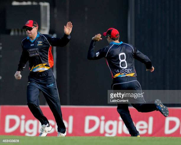 Ben Dunk of Antigua Hawksbills celebrates taking a catch to dismiss Darren Bravo of The Trinidad and Tobago Red Steel during a match between Antigua...