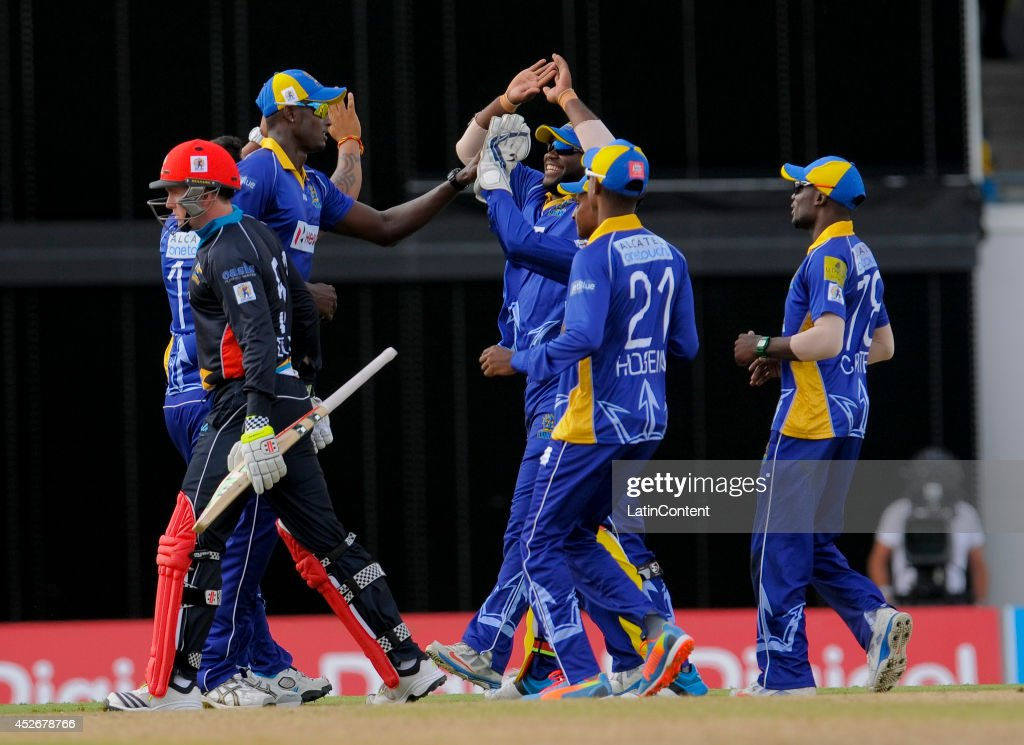 Ben Dunk (L) of Antigua Hawksbills walkes off out caught as Barbados Tridents celebrate during a match between Barbados Tridents and Antigua Hawksbills as part of the week 3 of Caribbean Premier League 2014 at Kensington Oval on July 25, 2014 in Bridgetown, Barbados.