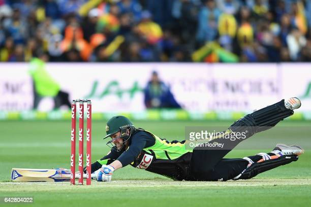 Ben Dunk of Australia dives to avoid being run out during the second International Twenty20 match between Australia and Sri Lanka at Simonds Stadium...