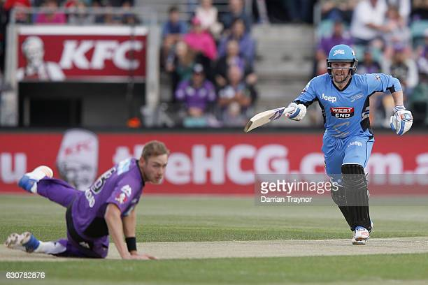 Ben Dunk of the Adelaide Stikers tries to run a single of the bowling of Stuart Broad of the Hobart Hurricanes during the Big Bash League match...