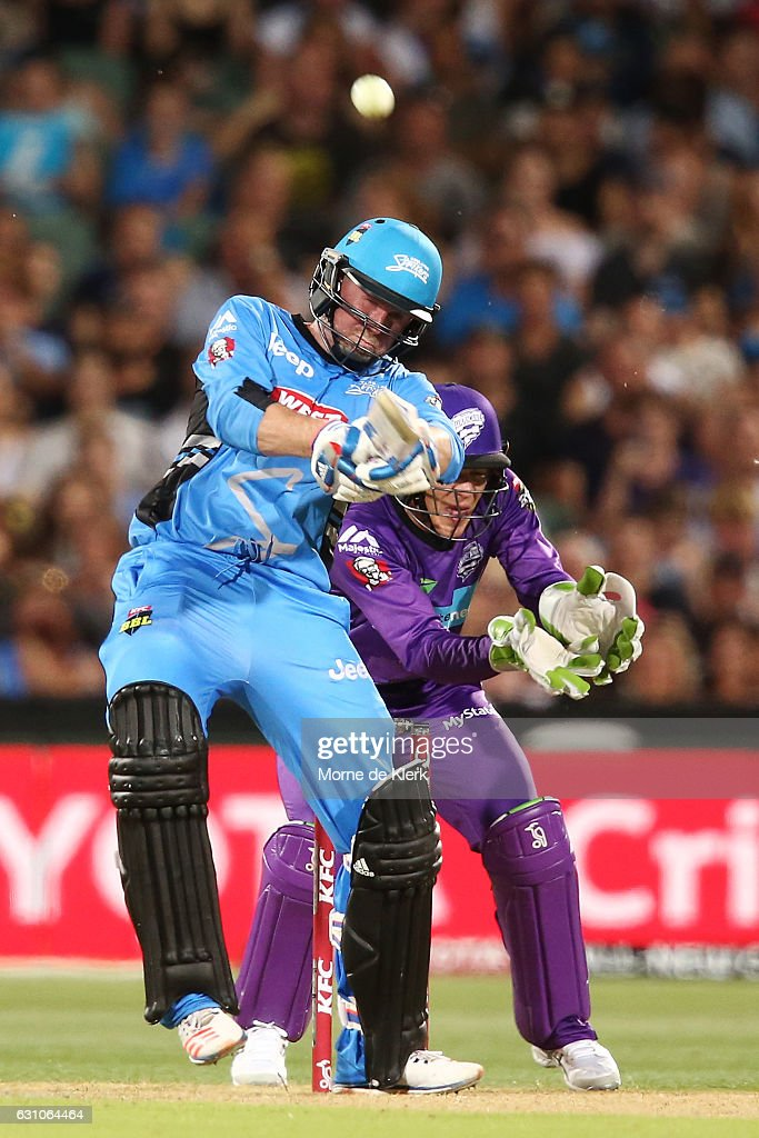 Ben Dunk of the Adelaide Strikers bats in front of Tim Paine of the Hobart Hurricanes during the Big Bash League match between the Adelaide Strikers and the Hobart Hurricanes at Adelaide Oval on January 6, 2017 in Adelaide, Australia.